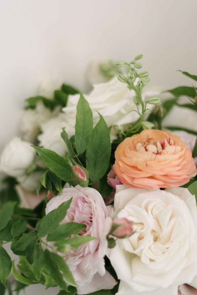 peach ranunculus and pink garden rose in bridal bouquet