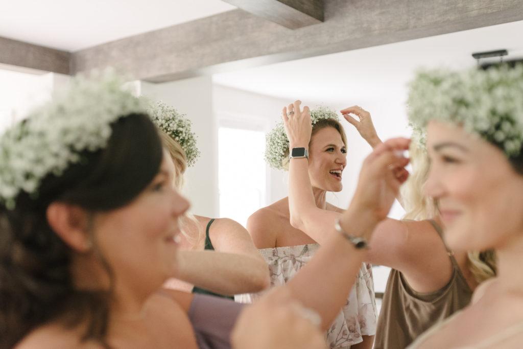 bridesmaids putting on babys breath flower crown