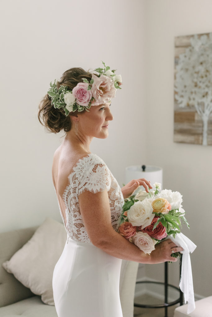 profile view of bride with bouquet